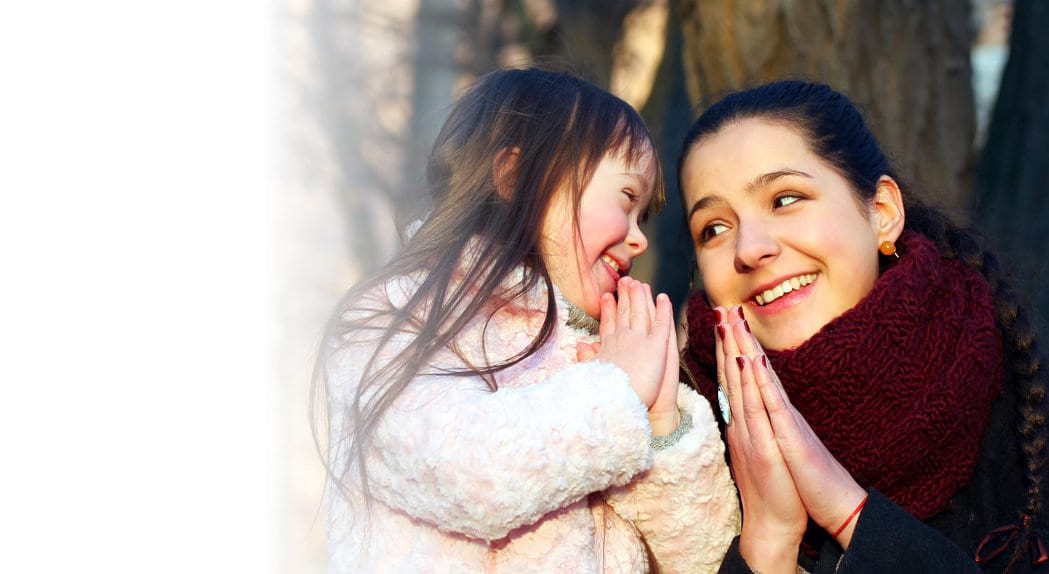 young woman and cute little child praying